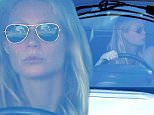 Gwyneth Paltrow drives away in her white Range Rover after attending longtime pal and Iron Man co-star Robert Downey Jr.'s party in Malibu, CA. X17online.com February 6, 2016.