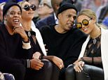 Alamy Live News. FEG4DN Oakland, Calif, USA. 6th Feb, 2016. Jay Z and Beyonce attend the Golden State Warriors game against the Oklahoma City Thunder on Saturday, Feb. 6, 2016, at Oracle Arena in Oakland, Calif. © Anda Chu/Bay Area News Group/TNS/Alamy Live News This is an Alamy Live News image and may not be part of your current Alamy deal . If you are unsure, please contact our sales team to check.