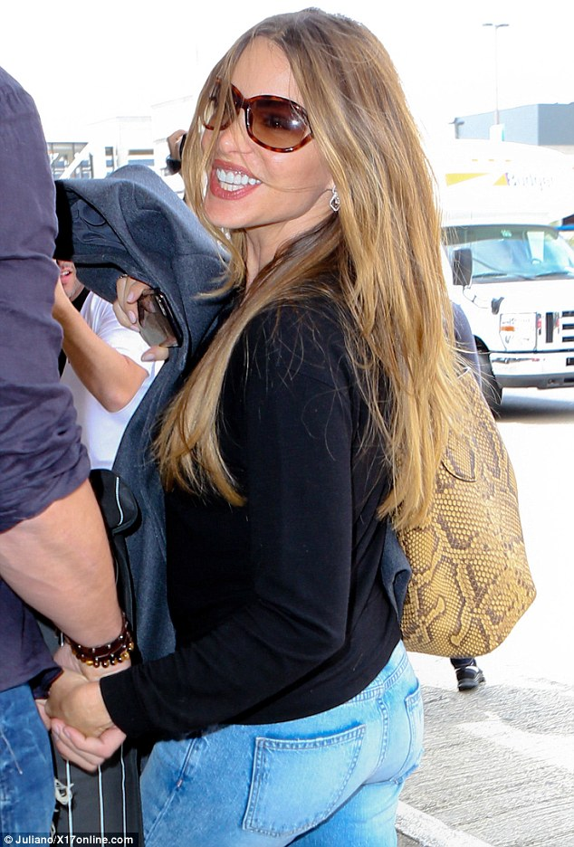 So happy together! Sofia Vergara flashed a bright smile while holding hands with her fiance Joe Manganiello while at LAX on Wednesday