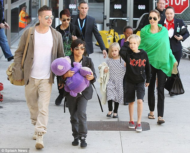 They have a lot of kids: The Pitts with Maddox, Pax, Vivienne, Zahara and Shiloh in February 2014 (Knox is not pictured)