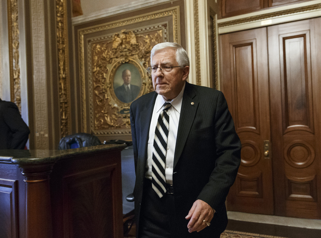 FILE - In this Jan. 14, 2014 file photo, Senate Budget Committee Chairman Sen. Mike Enzi, R-Wyo., leaves a closed-door GOP caucus luncheon on Capitol Hill in...
