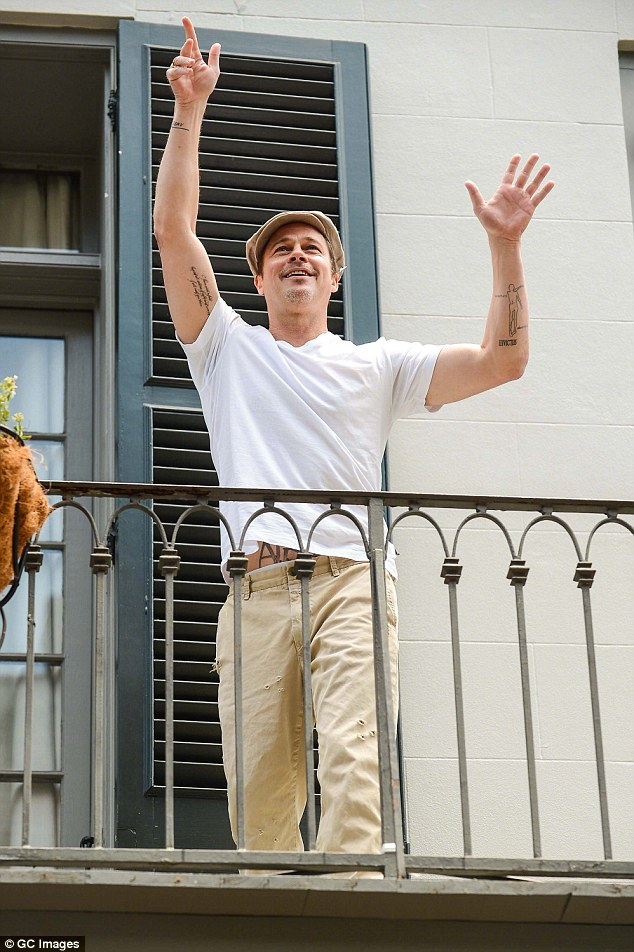 Loving the Big Easy: Pitt greeted Matthew McConaughey (not pictured) from his New Orleans balcony in May 2014