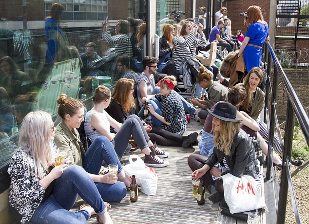 Visitors at last year's event take a break from the rummaging and enjoy a drink in the sunshine