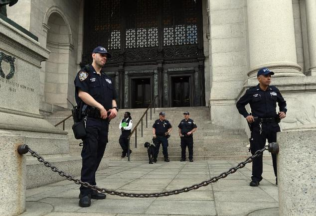 Police stand guard outside the American Museum of Natural History in New York on May 5, 2015