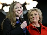 """CARROLL, IA - JANUARY 30:  Democratic presidential candidate former Secretary of State Hillary Clinton (R) is introduced by her daughter Chelsea while the two campaigned together at a 'Get Out The Vote"""" caucus' event at the Carrollton Inn January 30, 2016 in Carroll, Iowa. With two days to go before the Iowa caucuses, Hillary Clinton is campaigning throughout Iowa.  (Photo by Win McNamee/Getty Images)"""