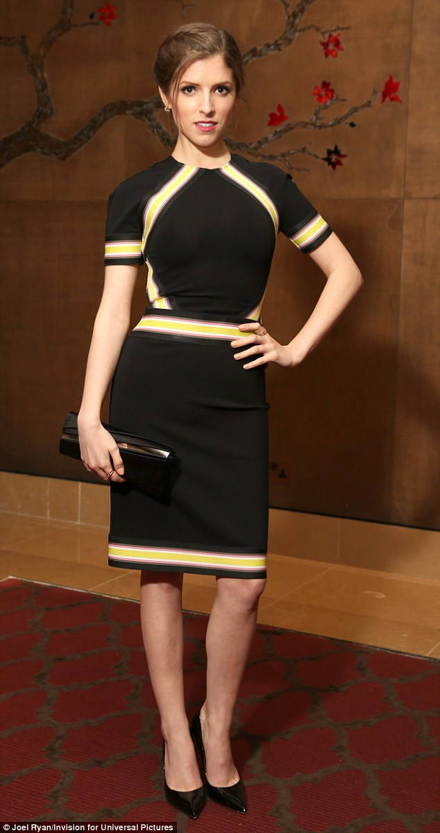 Looking good:During an evening screening of the film at a five-star hotel, the actress wore a striking black dress which featured yellow, white and purple panels across the arms, waist and hemline