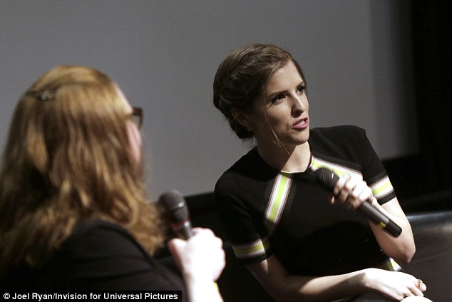 Demure: Keeping it classy for the occasion - which saw her answer a Q&A session from fans - she wore her hair up in a messy bun and wore some pointed heels