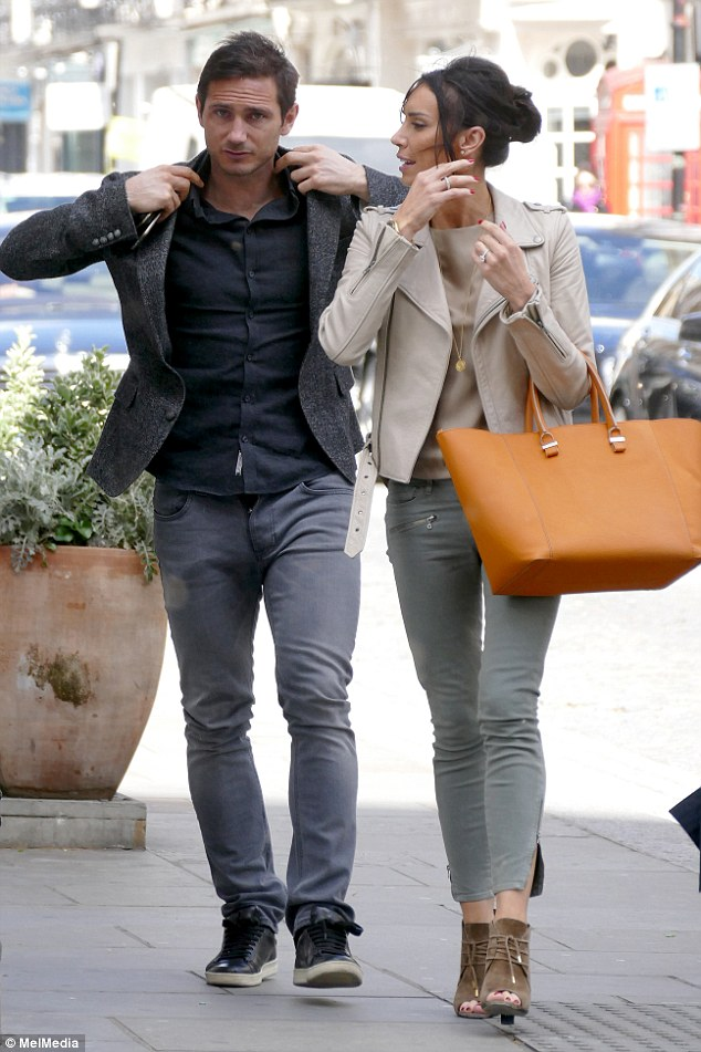 Casual couple: Frank Lampard and Christine Bleakley looked like their imminent move to New York was the last thing on their mind as they enjoyed a relaxing day out in London on Tuesday
