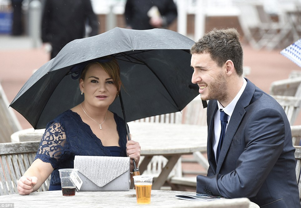 This couple didn't have to fight for a seat outside in the rain