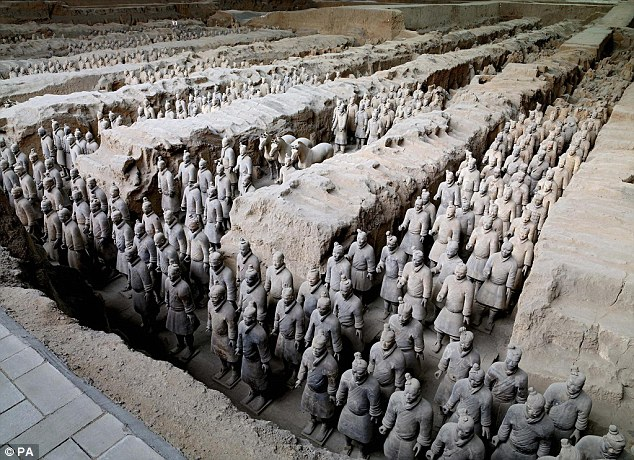 More than 6,000 terracotta warriors were unearthed in the enormous main pit (shown above), along with horses and weapons, less than a mile east of the tomb of China's first emperor Quin Shihuang in Xi'an