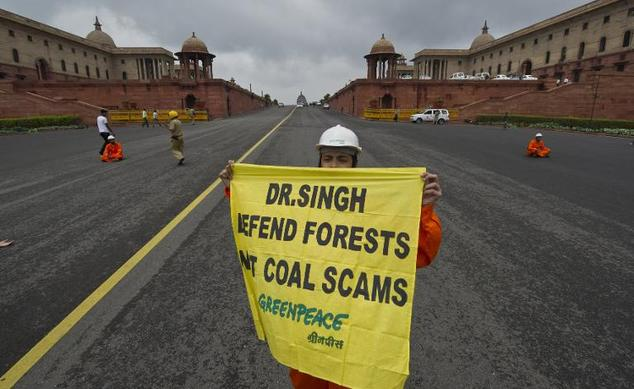 A Greenpeace activist in New Delhi in 2012. Greenpeace India warned that it may be forced to shut down its operations in the country within a month