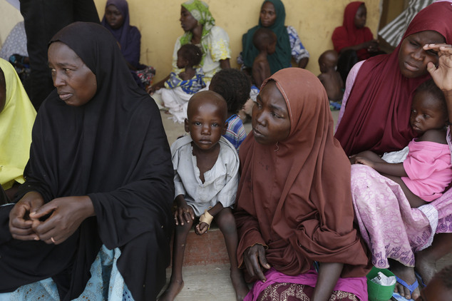 Women and children rescued by Nigerian soldiers from Boko Haram extremists at Sambisa Forest wait for treatment at at a refugee camp in Yola, Nigeria Monday,...