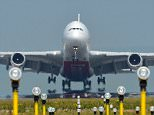 Heat reflecting off the runway at Manchester airport creates a mirage as planes take off. . REXMAILPIX.