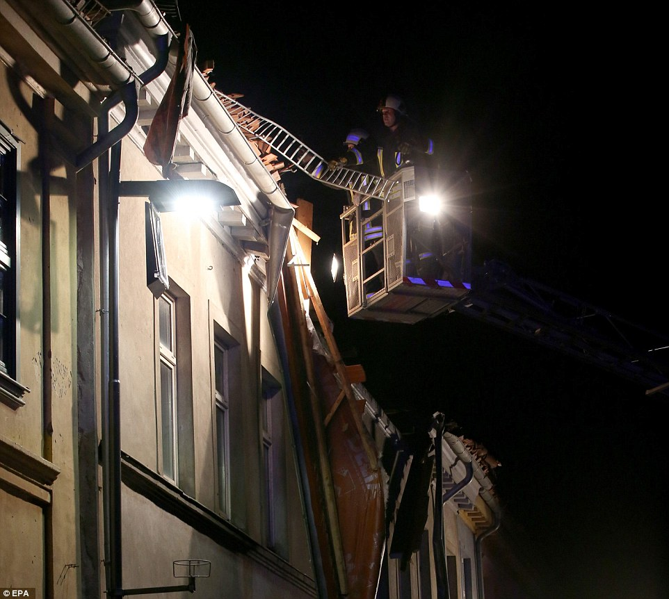 Damage to roofs made residents vulnerable to falling objects so the fire service worked through the night to stop building's becoming a hazard