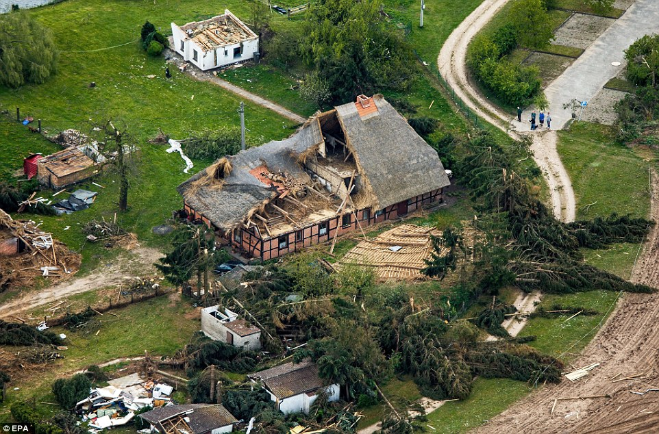 This thatched town house was almost completely destroyed by the storm. Residents and the authorities are now counting the cost