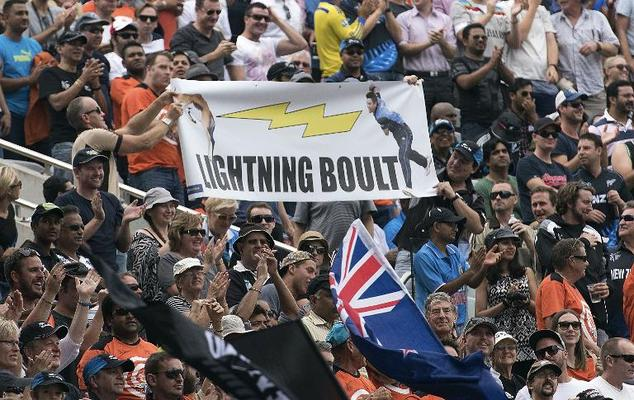New Zealand supporters celebrate during the Cricket World Cup semi-final match between New Zealand and South Africa at Eden Park in Auckland on March 24, 2015