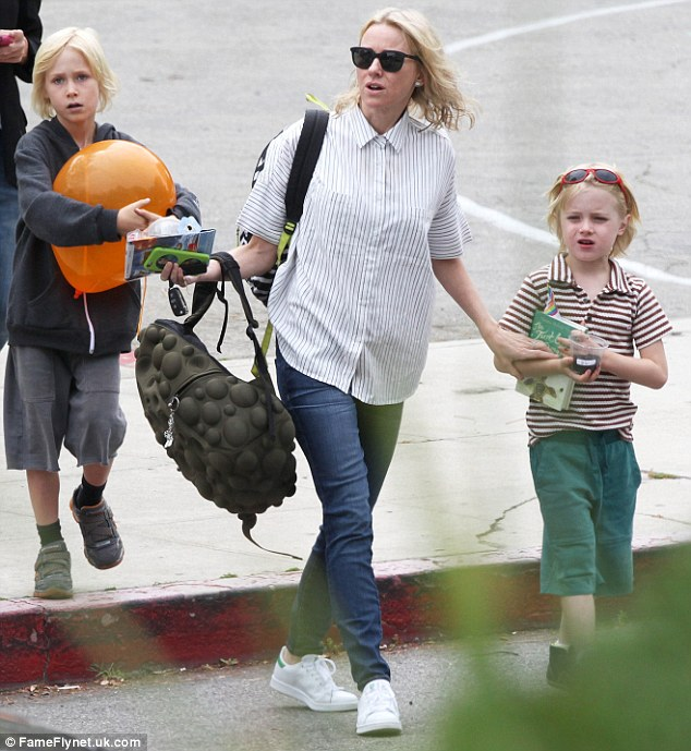 Blond ambition: Naomi Watts clutched her boys' hands tightly as they crossed the street when she picked them from school in New York on Tuesday