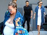 147774, EXCLUSIVE: Chrissy Teigen displays her large baby bump in a tight white dress as she arrives at a Super Bowl party with husband John Legend. Model, foodie and cookbook author Chrissy looked effortlessly chic in a long tight white dress accentuating her bump, a long denim shirt, heels and her hair in a top knot. The famous couple were seen carrying grocery bags from different stores including Whole Foods, Bristol Farms, Sur La Table and home delivery service Instacart as they arrived at a friends house with her mother Vilailuck, ahead of this afternoonís Super Bowl. Los Angeles, California - Sunday February 7, 2016. Photograph: © PacificCoastNews. Los Angeles Office: +1 310.822.0419 sales@pacificcoastnews.com FEE MUST BE AGREED PRIOR TO USAGE