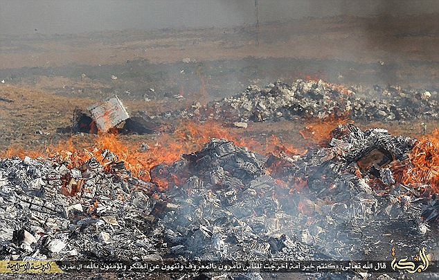 Anyone caught smoking in the areas of Syria and Iraq controlled by ISIS are punished by tens days in jail, and forced to pass an exam on Islam before being let out (pictured, cigarettes are burned by ISIS)