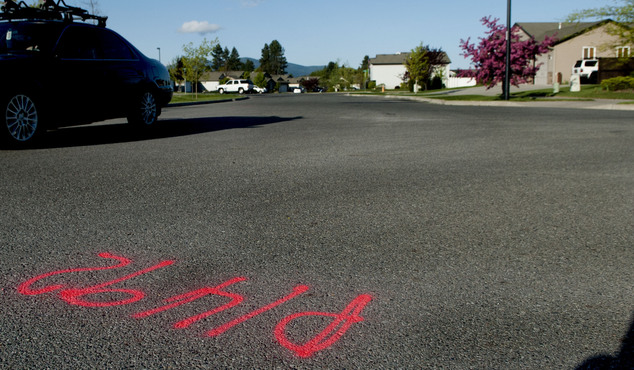 Police markings on the street at the 2800 block of West Wilbur in Coeur d'Alene, Idaho show the area where Police Sgt. Greg Moore was shot once around 1:30 a...