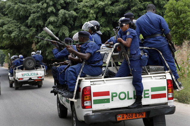 Police leave after clearing a barricade in the Kinindo district of Bujumbura, Burundi, Wednesday May 6, 2015.  Anti-government demonstrations continue Wednes...
