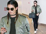 EXCLUSIVE TO INF.\nFebruary 08, 2016: Lily Aldridge and sister Ruby Aldridge greet each other with a long, warm hug as they are spotted jetting out of New York City from JFK airport.\nMandatory Credit: PapJuice/INFphoto.com Ref: infusny-285