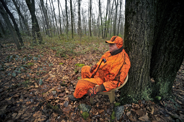 FILE - In this Dec. 1, 2014 file photo, Gene Romig of Lockport, N.Y., waits for deer as he hunts at Rothrock State Forest, in Huntingdon, Pa. A tough winter ...