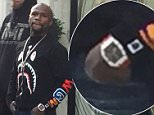 Floyd Mayweather goes shopping on Mount Street in London's Mayfair Christian louboutin store with an entourage of around 6men with 3 people carrier Mercedes parked up outside.  Also had 3 women with him, Valentine's Day shopping? Left the store with multiple bags. He is reportedley wearing a �400k watch  He was in there a while, the store wouldn't let anyone else in whilst he was inside.