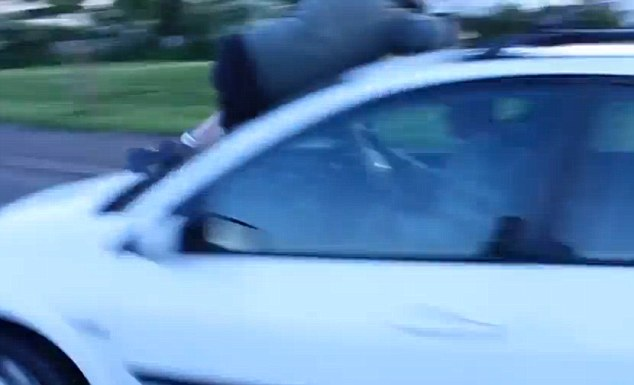 The video then shows the car driving forward with Hunter clinging to the Bonnet