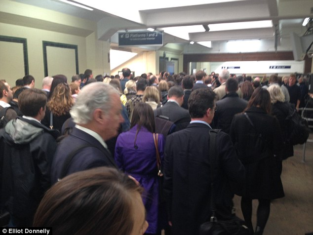 Queuing: The rail passenger who took this photo at Surbiton said he had experienced an 'awful' commute