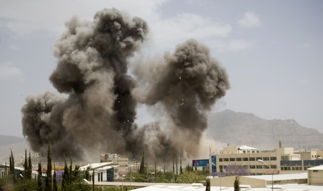 FILE - In this April 8, 2015 file photo, smoke billows from a Saudi-led airstrike, in Sanaa, Yemen. More than a month of relentless airstrikes by a coalition...