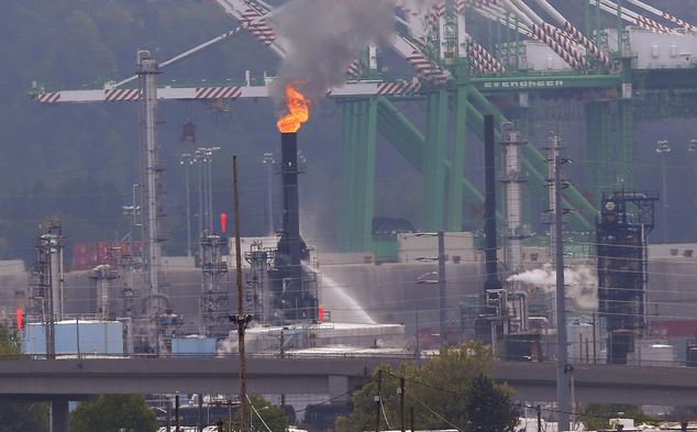 A fire burns at a U.S. Oil and Refining Co. facility Wednesday, May 6, 2015 in Tacoma, Wash. The Tacoma Fire Department says that no injuries or evacuations ...