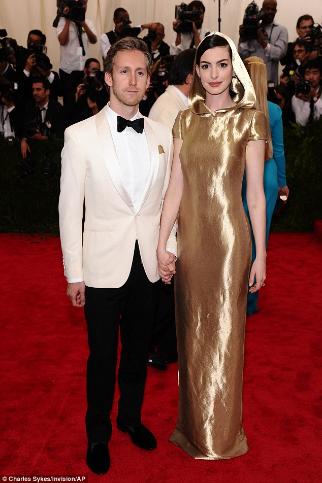 Golden girl: At the Met Gala, she shimmered in a metallic hooded gown by Ralph Lauren, which looked to have been inspired by Star Wars day as it mirrored the uniform of the Jedi knights