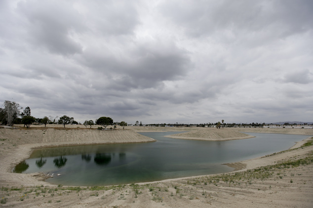 A water holding pond at the Orange County Water District, recharge facility is filled to less then 20 percent of it's capacity, Wednesday, May 6, 2015 in Ana...