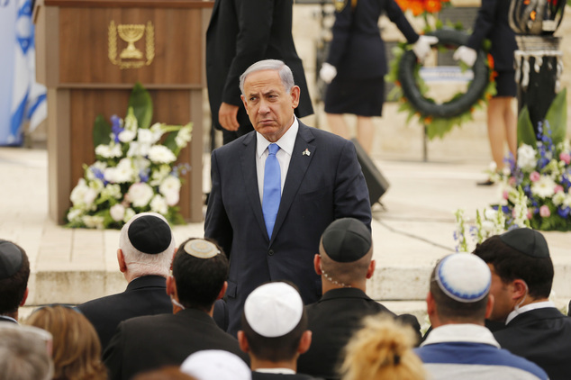 FILE - In this Wednesday, April 22, 2015 file photo, Israel's Prime Minister Benjamin Netanyahu leaves the podium after speaking during a Memorial Day ceremo...