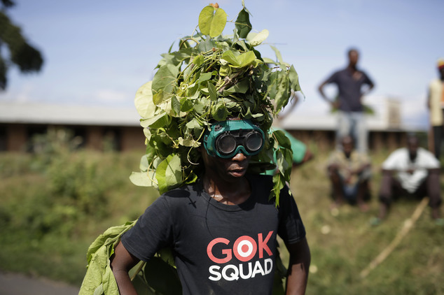 A demonstrator seem to be dressed as trees as he walks with others to a barricade in the Musaga district of Bujumbura, Burundi, Wednesday May 6, 2015.  On Tu...