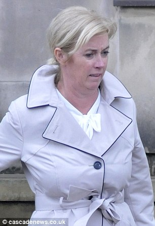 Joanne Kirk, 49, pictured outside Bolton Crown Court, is accused of wrongly claiming disability benefits