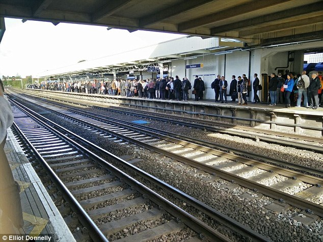 Stuck on the platform: Today's problems at Surbiton (above) followed a power failure yesterday which affected services run by the Southern train company