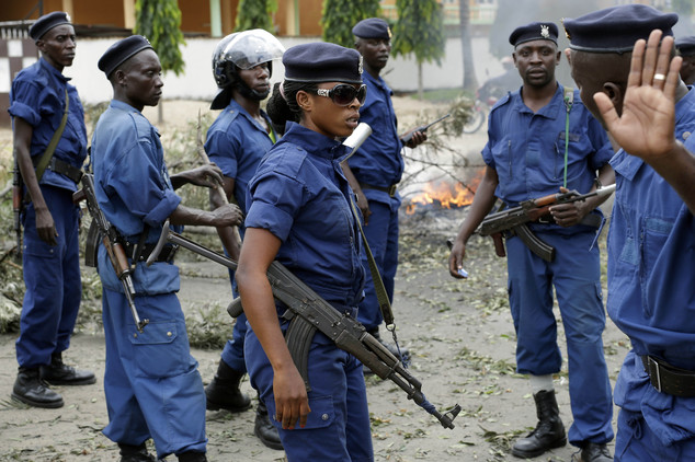 Police clear and secure a barricade in the Kinindo district of Bujumbura, Burundi, Wednesday May 6, 2015. Anti-government demonstrations continue Wednesday a...