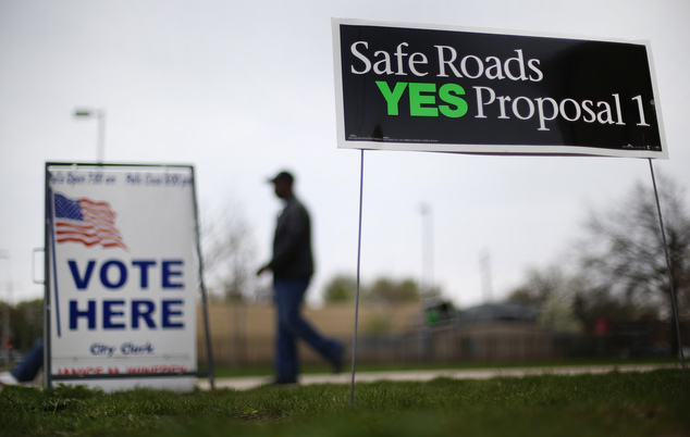 A voter leaves a polling location in Detroit Tuesday, May 5, 2015. Michigan voters were deciding Tuesday whether to approve higher taxes to improve the state...