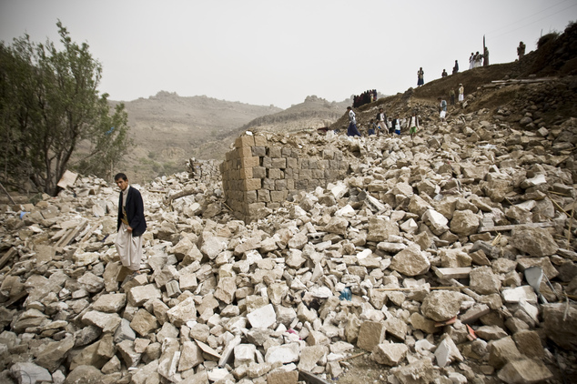 FILE - In this Saturday, April 4, 2015 file photo, Yemenis search for survivors in the rubble of houses destroyed by Saudi-led airstrikes in a village near S...