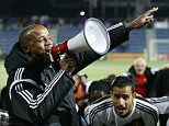 Belgium's Vincent Kompany, left, celebrates with a megaphone after their team victory over Andorra during the Euro 2016 group B qualifying match between Andorra and Belgium at the Estadi Nacional stadium in Andorra la Vella, Andorra, Saturday, Oct. 10, 2015. (AP Photo/Manu Fernandez)
