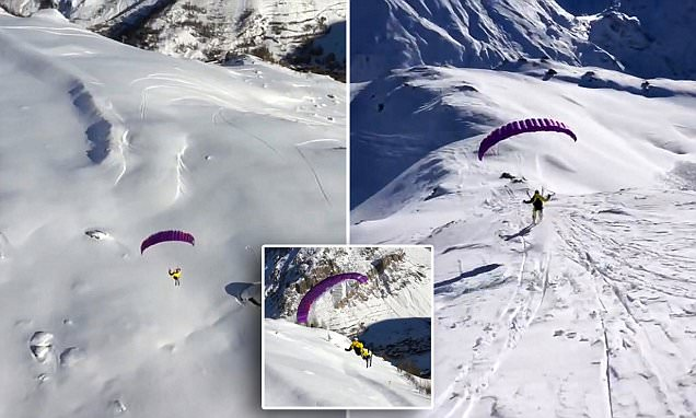 Video shows daredevils race down Val d'Isereslopes with skis and PARACHUTES