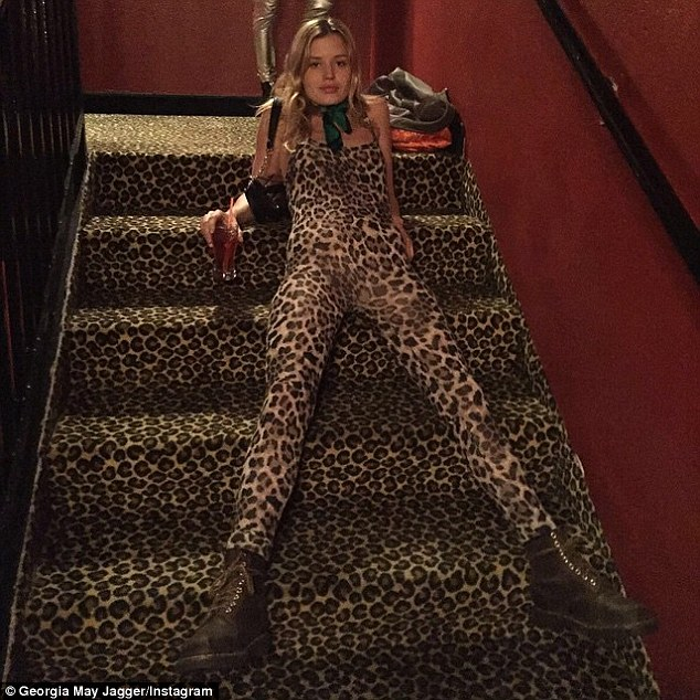 Spot the supermodel! The fashion icon also bore a striking resemblance to a patterned staircase in her colourful jumpsuit, and decided to highlight the similarities by draping herself on the floor