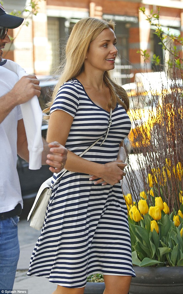 Mother-to-be: Katherine, who was clad in a simple stripy dress, placed a protective hand on her baby bump