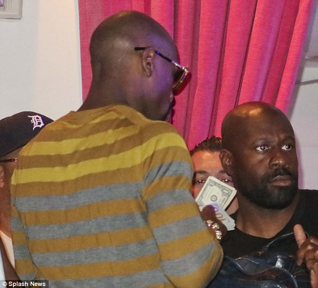 Flashing the cash:Floyd Mayweather Jr. (left) showed up at Chris Brown's birthday party flashing a tiny bit of the hundreds of millions he earned during his boxing match last weekend. The haul included $1 bills!