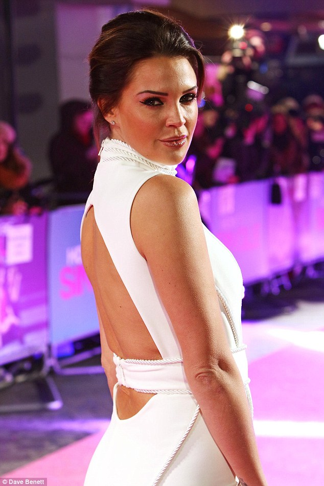 Showing a hint of skin: Braving the cold temperatures and damp weather at the Vue cinema in Leicester Square, the 32-year-old model made sure to showcase her figure to the max in a white bodycon dress
