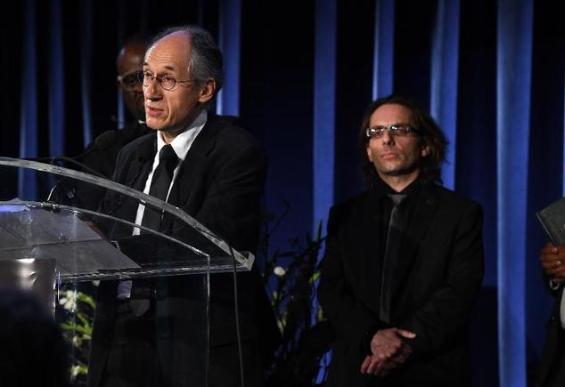 Charlie Hebdo chief editor Gerard Biard (left) speaks at the PEN Literary Gala on May 5, 2015 in New York
