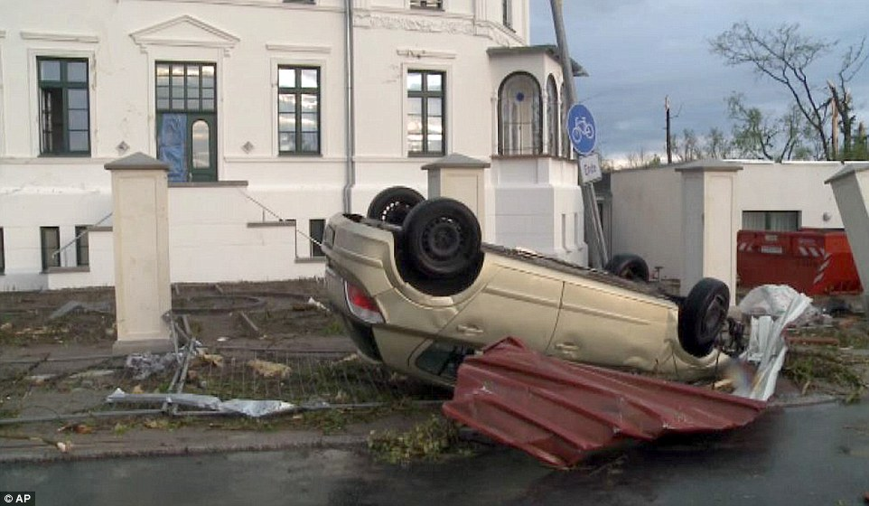 Huge power: The winds in north east Germany were so strong that they actually flipped this car onto its roof