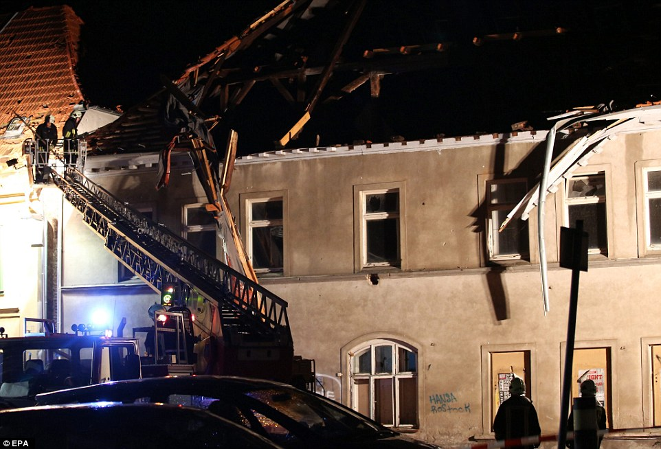 The tornado has caused widespread damage in a small town called Bützow, ripping off most of a church roof and covering streets in debris